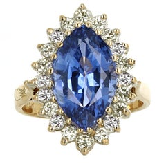 GIA Certified, 8.11 Carat Marquise Shape Sapphire and Diamond Engagement Ring