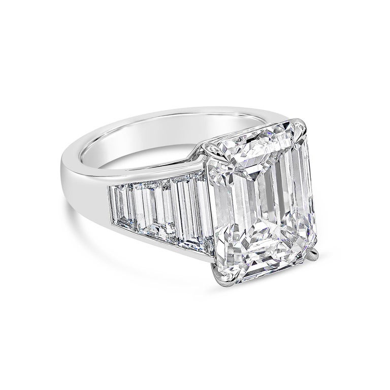A stunning well-crafted engagement ring showcasing an 8.35 carat emerald cut diamond certified by GIA as H color, VVS2 clarity. Flanking the center diamond are perfectly matched graduating trapezoid diamonds, channel set in a polished platinum