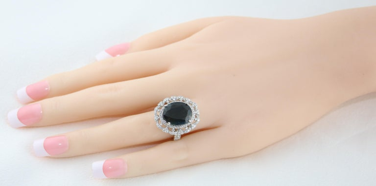 Contemporary GIA Certified 8.49 Carat Oval Dark Greenish Blue Sapphire and Diamond Ring For Sale