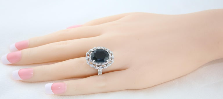 Oval Cut GIA Certified 8.49 Carat Oval Dark Greenish Blue Sapphire and Diamond Ring For Sale
