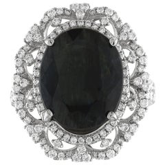 GIA Certified 8.49 Carat Oval Dark Greenish Blue Sapphire and Diamond Ring