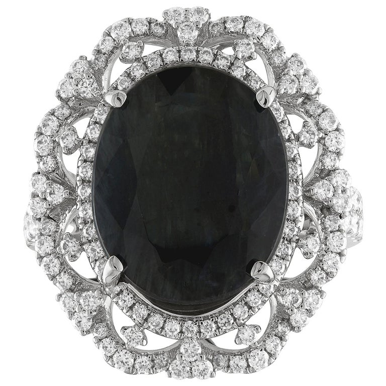 GIA Certified 8.49 Carat Oval Dark Greenish Blue Sapphire and Diamond Ring For Sale