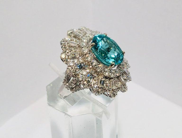 Oval Cut GIA Certified 9.02 Carat Paraiba Tourmaline and Diamond 18 Karat White Gold Ring For Sale