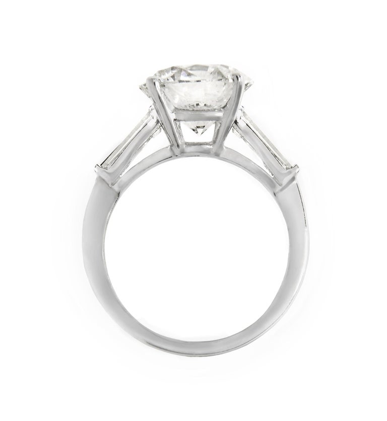 Platinum GIA Certified Round Brilliant Cut Engagement Ring, features 9.05 Carats F Color SI1 in Clarity, Certified BY GIA. Set with 1.00 carat total weight of baguettes