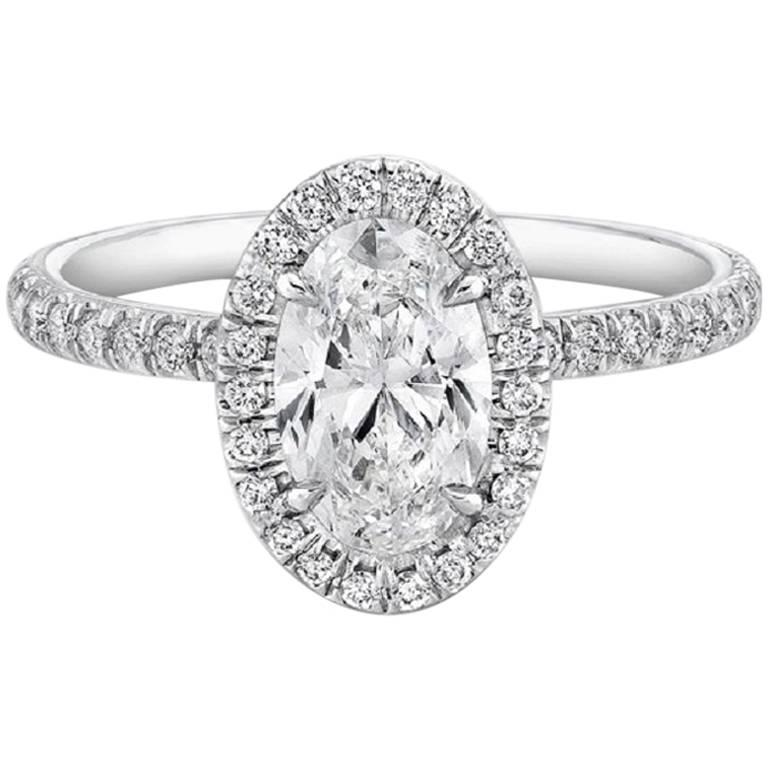 GIA Certified .91 Carat Oval Diamond Engagement Ring For Sale