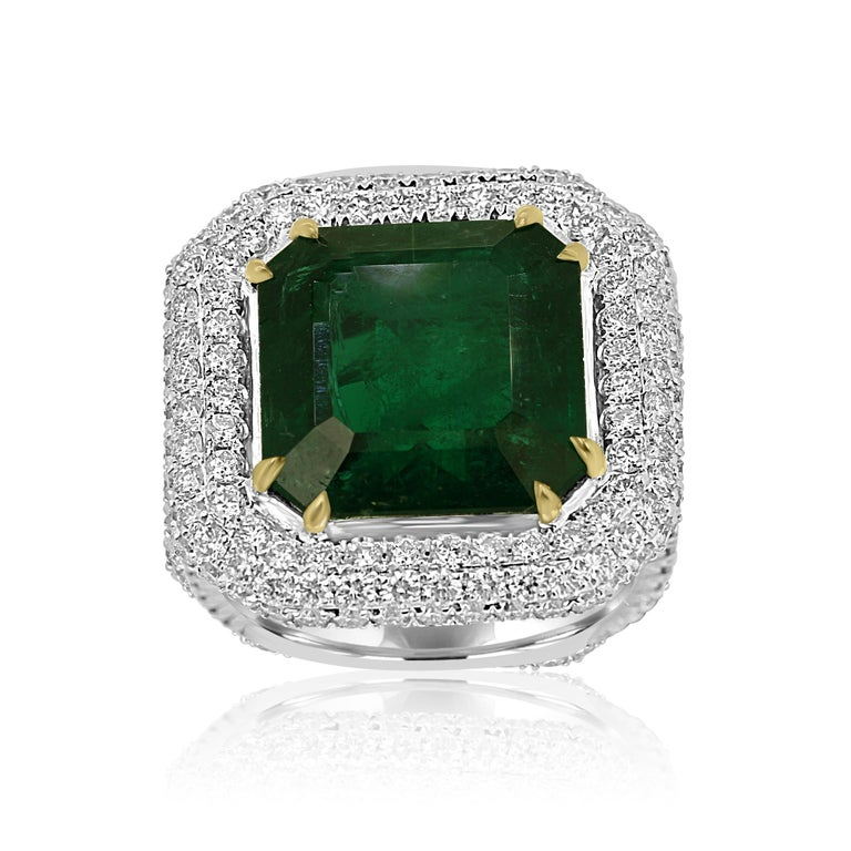 Stunning GIA certified 9.57 Carat Minor Zambian Emerald Cut Emerald encircled in triple Halo of Colorless VS-SI diamonds 2.21 Carats in stylish one of a kind handmade 18K White and Yellow Gold Cocktail Statement Ring.  MADE IN USA  Center Emerald