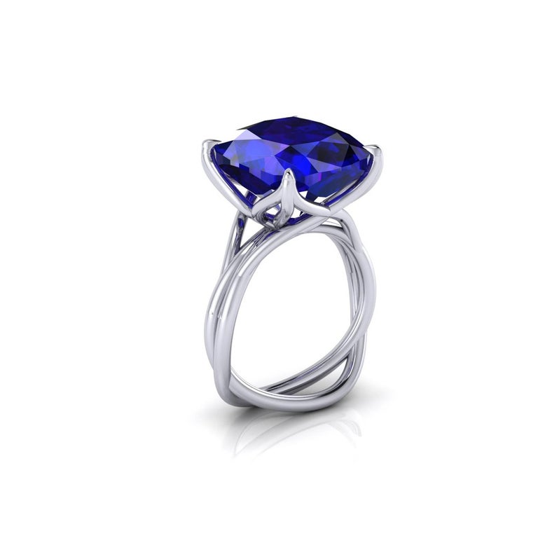 A Spectacular 9.23 carat natural Tanzanite of a deep blue and purple refractions, unique in its splendor, GIA Certified, in a one of a kind, hand made 18k white gold ring, designed and conceived in New York City. A design that recall nature's vines