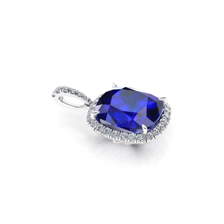 9.61 carat natural Tanzanite of a deep blue and purple refraction, GIA Certified, with a halo of white round and marquise diamonds set everywhere under the basket and on the bail, for an approximate total diamond weight of 1.35 carats, 18k white