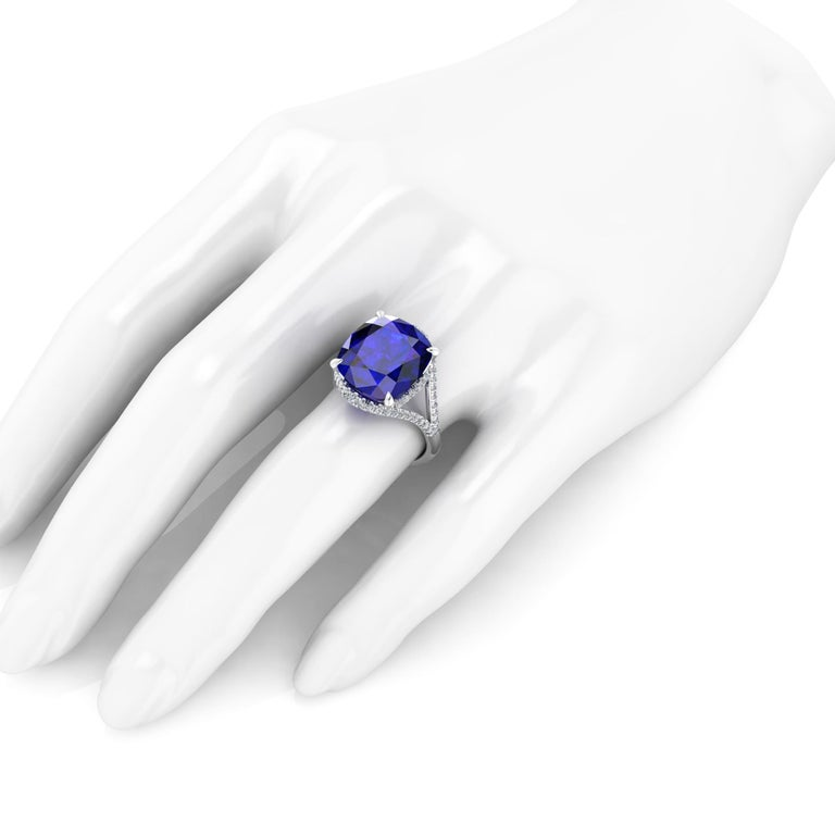 9.23 carat deep blue Tanzinite  GIA Certified, in a one of a kind, hand made Platinum 950, adorned by 0.60 carats of white diamonds pave, designed and conceived in New York City.  This ring is made to order to guarantee the absolute immaculate