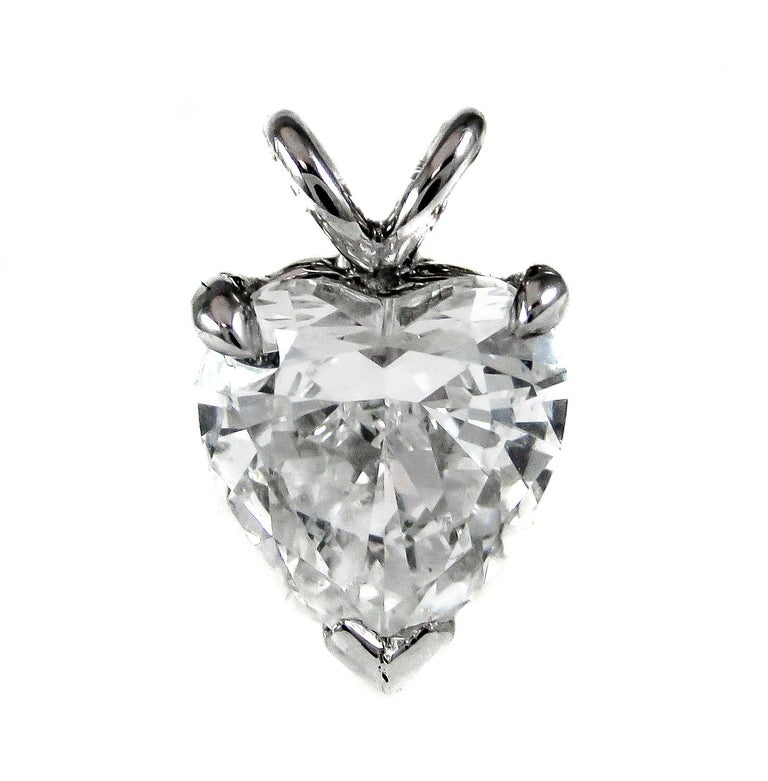 A chic bright white heart shaped diamond, with a GIA color grade of D and clarity VS2, is set in a platinum prong setting and chain that is great for everyday wear. The extremely well cut heart-shape diamond displays an incredible amount of sparkle,