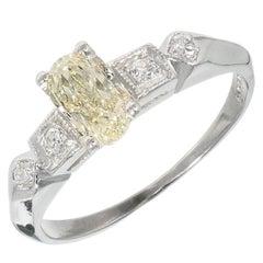 GIA Certified .57 Carat Oval Light Yellow Diamond Platinum Engagement Ring