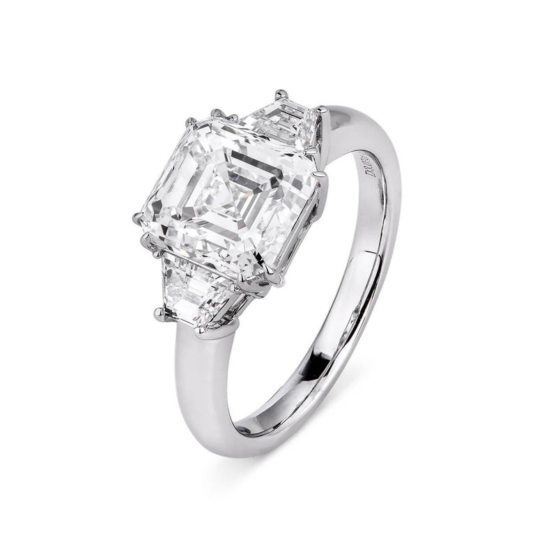 ASHER CUT DIAMOND RING - 3.58 CT   Set in 18KT White gold   Total diamond weight: 3.01 ct  [ 1 diamond ] Color: E Clarity: SI1  Total side diamond weight: 0.57 ct [ 2 diamonds ] Color: F Clarity: VS  Total ring weight: 4.27 grams   GIA Certified