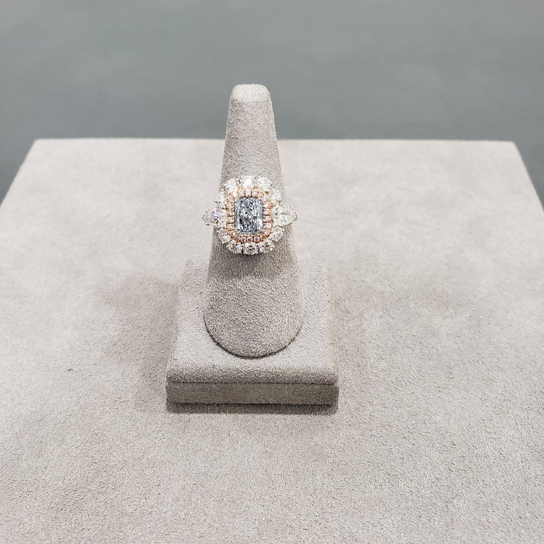 Contemporary GIA Certified Blue Diamond Halo Engagement Ring For Sale