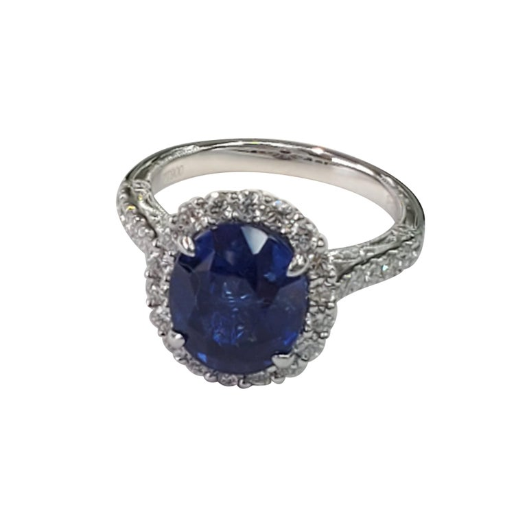 GIA CERTIFIED  Blue Sapphire - 5.72ct  White Diamonds - 0.90ct  Platinum Ring
