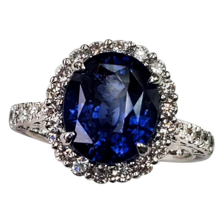 GIA Certified Blue Sapphire Oval Ring with White Diamonds For Sale