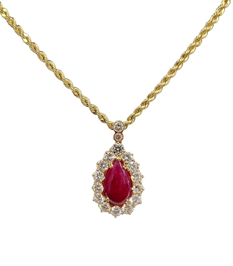 GIA certified, no heat cabochon ruby and diamond pendant and earring set. The rubies in the pendant and earrings are all GIA certified and show no indication of heating. The pendant and earrings are made with 18 karat yellow gold, the chain in 14