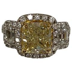 GIA certified Center 3.5 Carat Yellow Diamond Ring