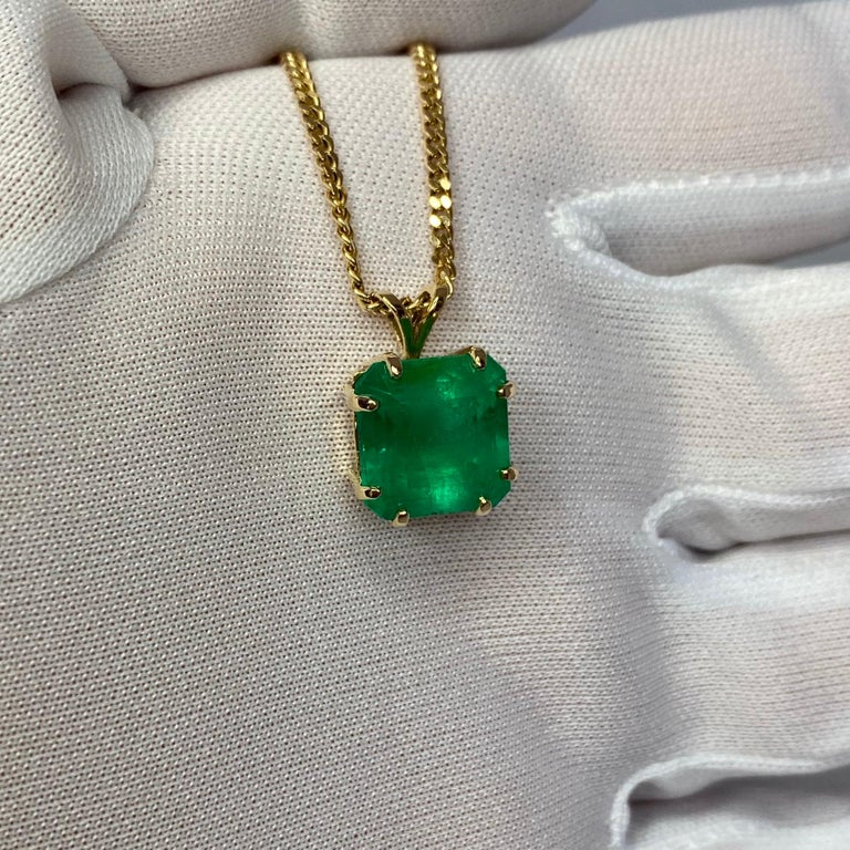 Large top quality 5.99 carat Colombian emerald set in a fine 14k yellow gold solitaire pendant.  Emerald fully certified by GIA New York Lab confirming stone as natural and Colombian in origin. Also describing treatment as only 'minor enhancement'.