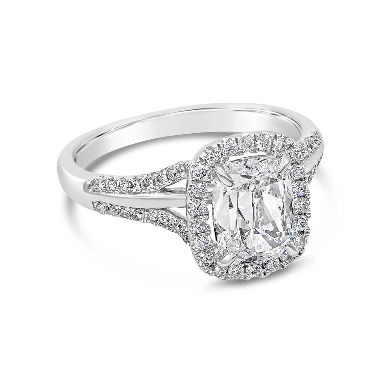 Showcasing a 1.66 carat cushion brilliant diamond certified by GIA as D color, SI2 clarity, surrounded by a single row of round brilliant diamonds. Set in a chic split-shank setting accented with diamonds. Accent diamonds weigh 0.33 carats total.