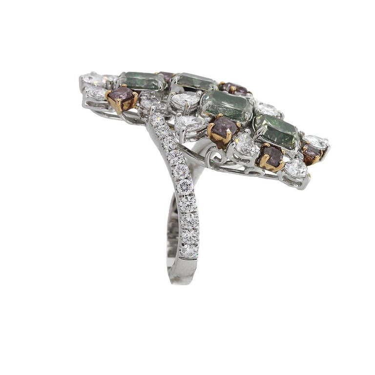 Material: 18k white gold Diamond Details: 0.92ct Cushion Cut Diamond. Diamond is Fancy yellowish grey in color. HRD #15007437031 0.90ct Cushion cut diamond. Diamond is Fancy yellowish grey in color. HRB #15015545010 0.93ct cushion cut diamond.