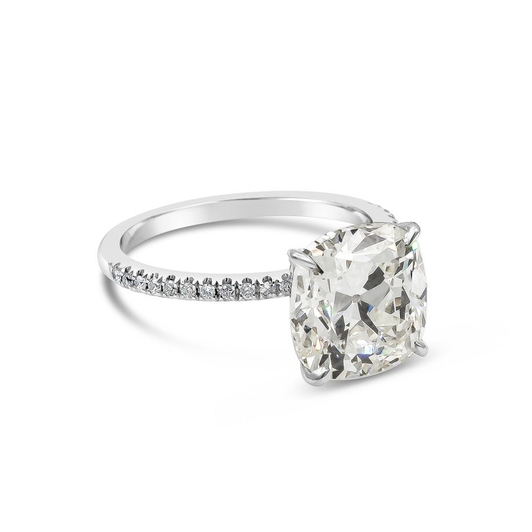 A classic engagement ring style showcasing a 4.68 carat cushion cut diamond center stone, set in a very thin, platinum band accented with diamonds. GIA certified the center diamond as K color, VS2 clarity.   Style available in different price