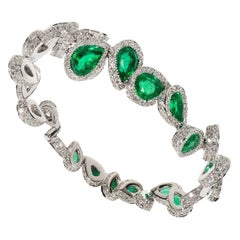 GIA Certified Diamond and Emerald Clamper Bracelet in 19.2 Karat White Gold