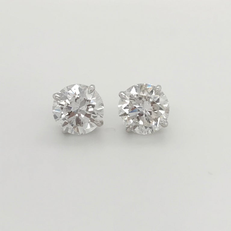 GIA Certified Diamond Stud Earrings weighing 4.71 Carats. Color: E-F Clarity: I1-I2 4 Prong Classic Setting   Harbor Diamonds specializes in diamond studs, tennis bracelets and riviere necklaces.