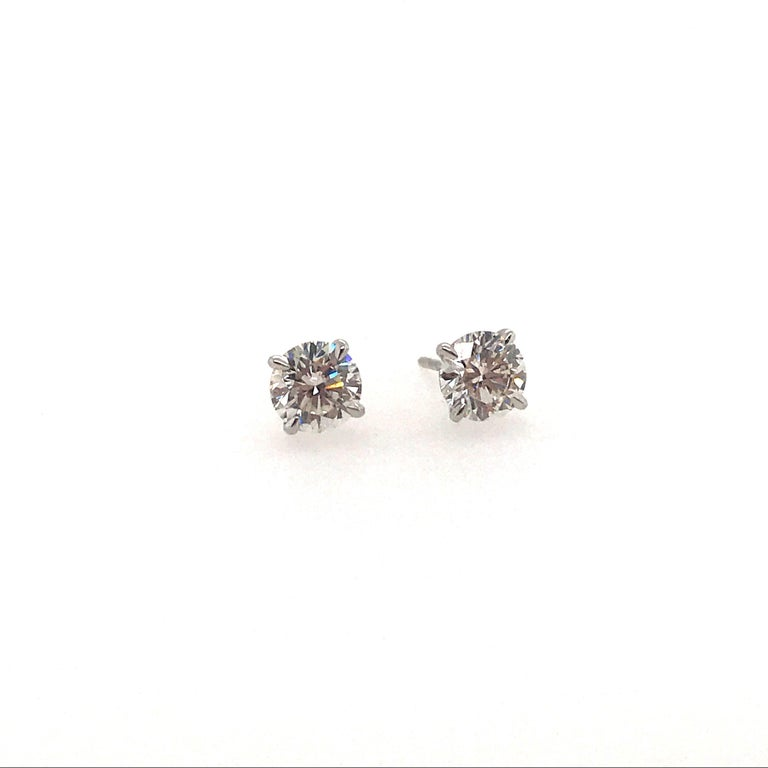 GIA Certified diamond stud earrings weighing 1.40 carats, in a 4 prong martini setting. Color H-I Clarity VS2-SI1
