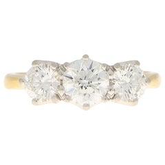 GIA Certified Diamond Three-Stone Engagement Ring Set in 18 Karat Yellow Gold