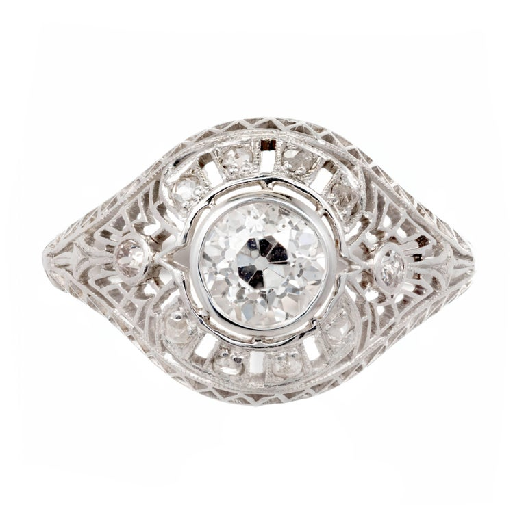 Original vintage 1910 Edwardian handmade Diamond platinum filigree dome engagement ring. Set with an old European cut GIA certified center diamond. The delicate open work is hand set with nice original rose cut diamonds.  1 old European diamond G