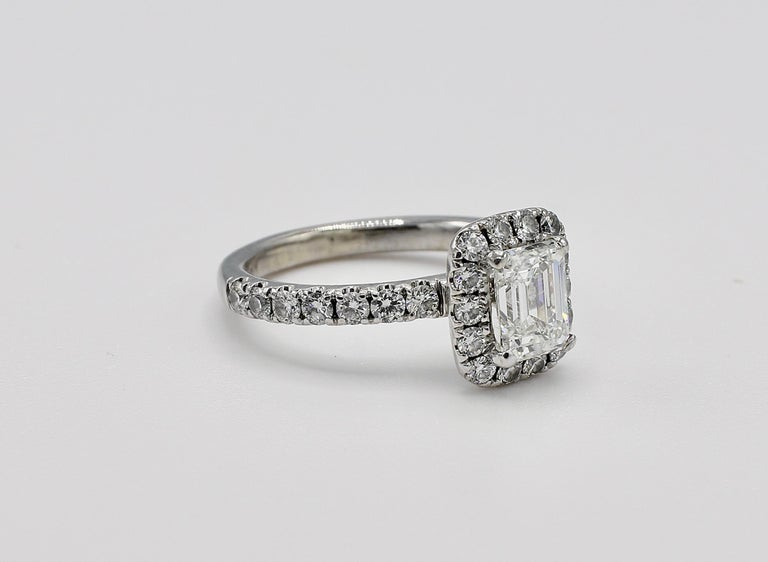 GIA Certified Emerald Cut 1.01 Carat H VS2 Halo White Gold Diamond Engagement Ring Size 5.75   GIA Report Number: 2307547385 (see report copy pictured for details) Shape: Emerald cut Carat weight: 1.01 carat Color: H Clarity: VS2  Polish: