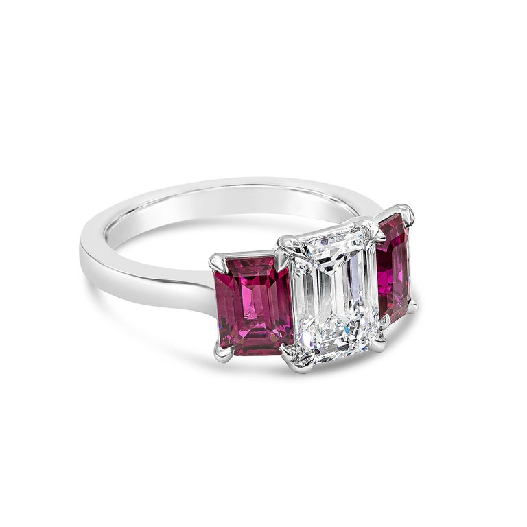 A very gorgeous piece of jewelry showcasing a 1.62 carat emerald cut diamond certified by GIA as E color, VVS1 clarity. Flanking the center diamond are two color-rich emerald cut rubies weighing 1.04 and 1.08 carats respectively, certified by GIA as