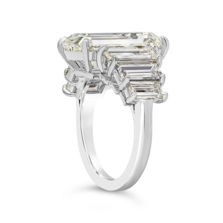 A unique and special engagement ring showcasing an 8.09 carat emerald cut diamond, flanked by three step-cut trapezoid diamonds on each side. Diamonds weigh 3.75 carats total. Set in a polished platinum mounting. GIA Certified center diamond as K