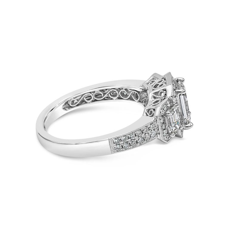 Contemporary GIA Certified Emerald Cut Diamond Three-Stone Halo Engagement Ring For Sale