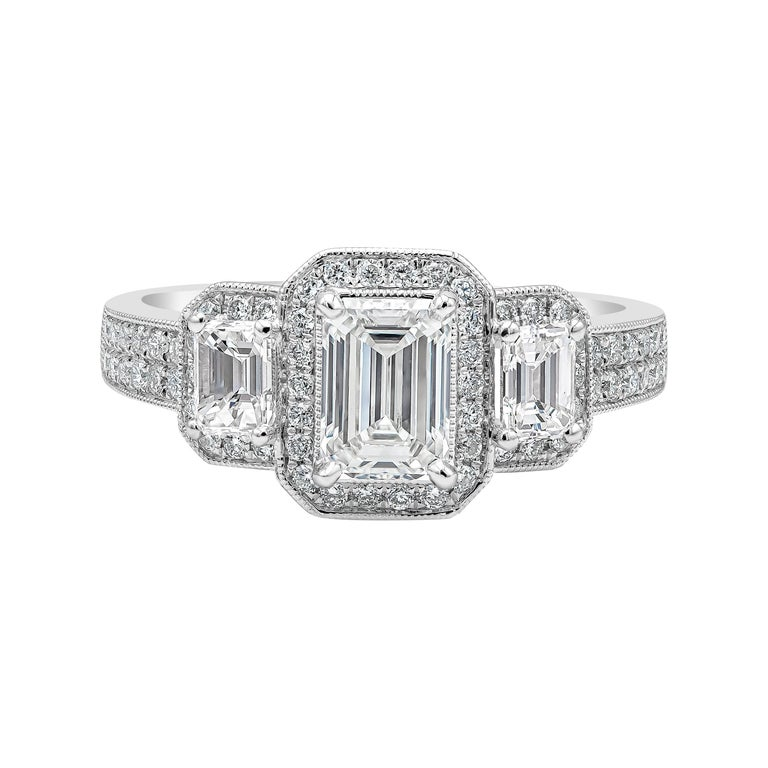 GIA Certified Emerald Cut Diamond Three-Stone Halo Engagement Ring For Sale