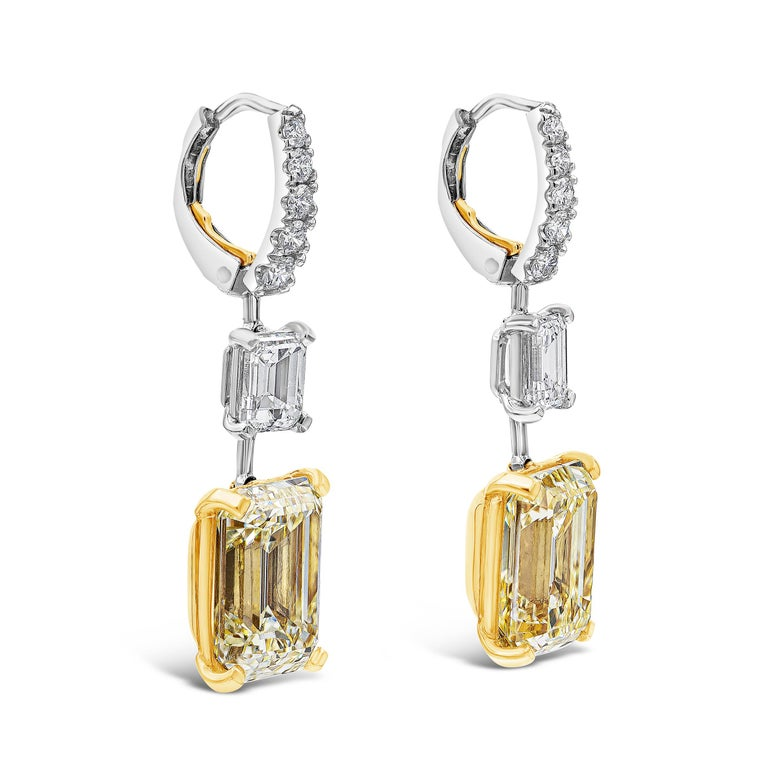 These gorgeous earrings features two GIA certified Emerald Cut Yellow Diamonds set in a leverback setting accented by 0.35 carat total round brilliant diamonds. Spacing the yellow diamonds are two GIA certified white diamonds.  Yellow Diamond: 5.31