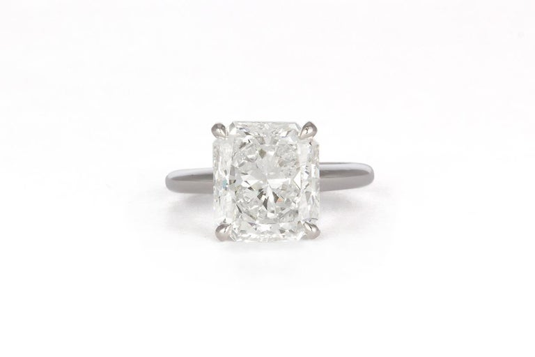 We are pleased to offer this GIA Certified 14K White Gold & Radiant Diamond Solitaire Engagement Ring. This beautiful ring features a GIA certified & laser inscribed 5.05ct F/VS2 Radiant cut diamond set in a 14k White Gold 4 prong solitaire setting.