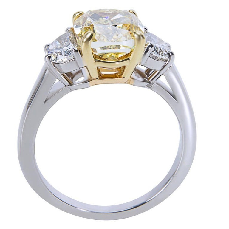 Natural Intense Fancy yellow GIA certified.  Center 2.55 ctw Natural Fancy Yellow - IF Side Stone Half Moons 1.00 ctw  Ring size is 5.75 and resizable. This engagement ring is brand new and unworn. Comes with GIA certificate.