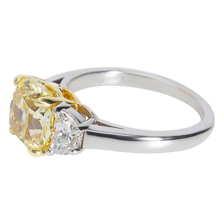 Modern GIA Certified Fancy Intense Yellow Cushion Diamond Engagement Ring 3.55 Carat For Sale