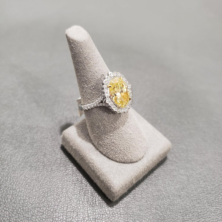 Oval Cut GIA Certified Fancy Intense Yellow Diamond Halo Engagement Ring For Sale