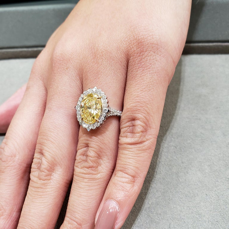 Women's GIA Certified Fancy Intense Yellow Diamond Halo Engagement Ring For Sale