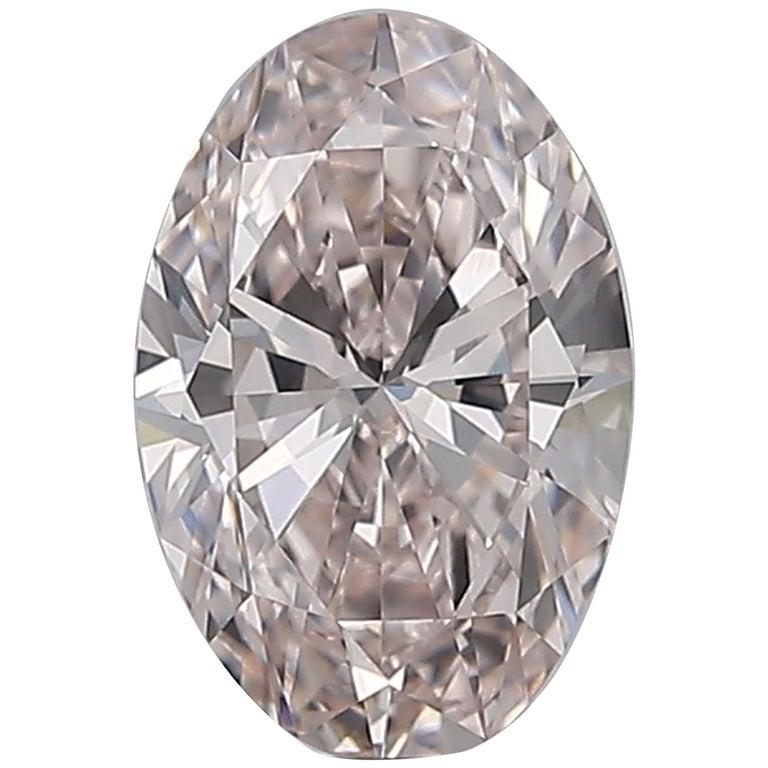 GIA Certified Fancy Pink Oval Diamond 0.81 Carat VVS1 For Sale