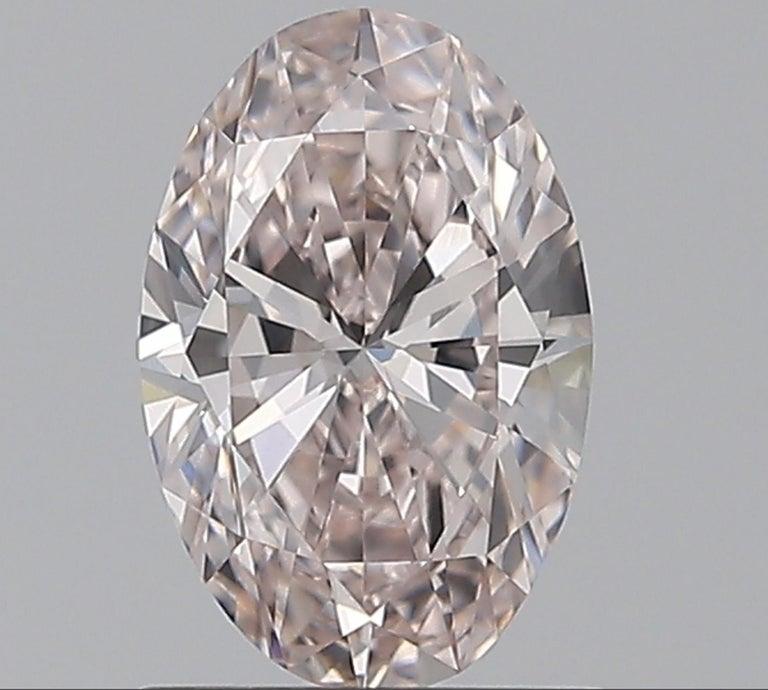 GIA Certified Fancy Pink Oval Diamond 0.81 Carats VVS1