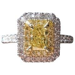 GIA Certified Fancy Vivid Yellow 0.60 Carat Double Halo Radiant Diamond Ring
