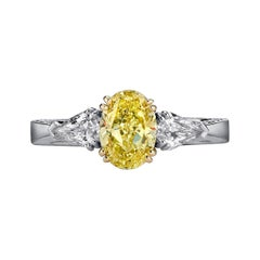 GIA Certified, Fancy Yellow 1.18 Ct, Platinum, Two .75ct Kite Diamonds