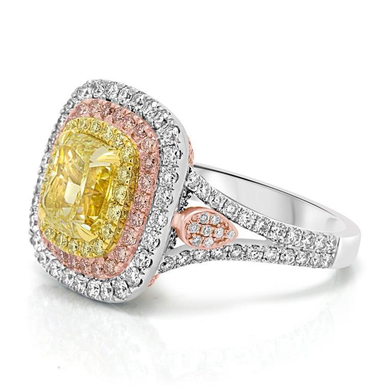 Stunning 2.41 Carat GIA certified Fancy Light Yellow Cushion Cut Diamond SI2 Clarity Encircled in Triple Halo of Natural Fancy Yellow Diamond Rounds 0.50 Carat, Natural Pink Diamond Rounds 0.52 Carat and White Diamond Rounds 0.79 Carat in 18k White,