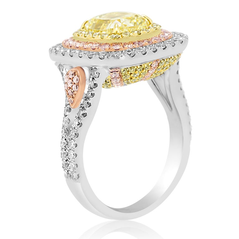 GIA Certified Fancy Yellow Diamond Cushion Triple Halo Three-Color Gold Ring In New Condition For Sale In NEW YORK, NY