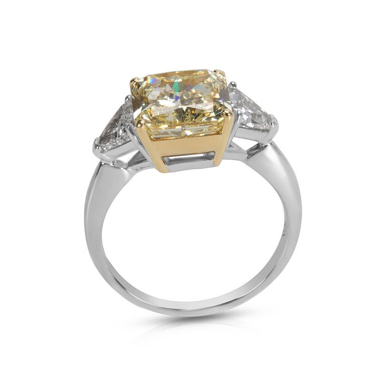 Center diamond is a Natural Fancy Light Yellow. Recently polished to excellent condition. Photos of actual item. Ring Size 6.5 Center Stone Type : Diamond Center Stone Shape : Radiant Center Stone Weight  (cts) : 4.20 Center Stone Color: Fancy Light