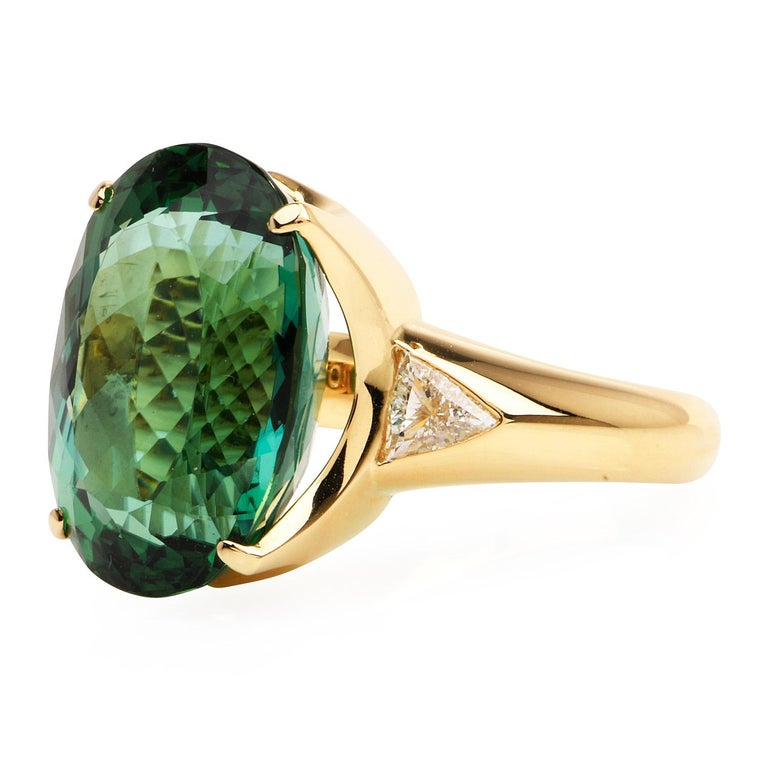 This exquisite Green Tourmaline Cocktail Ring is a splash of color with an effortless sparkle, Crafted in solid heavy 18K yellow gold, the center is adorned by a GIA certified Green Tourmaline, Oval cut, Prong-set, weighing approximately 19.42