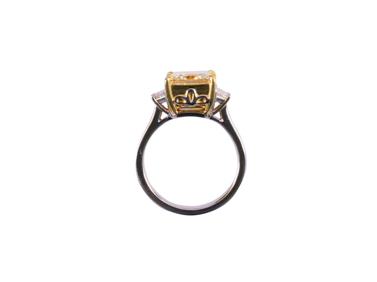 Raregemworld's stunning Natural Yellow and White 3 Stone Diamond Ring.  GIA certified 3.03 cts Natural Light Yellow (WX) Princess Cut Diamond set with 2 white Trapezoids 0.39 cts total.  Set in 18K Gold Size 6 1/2 (sizable upon request) Don't forget